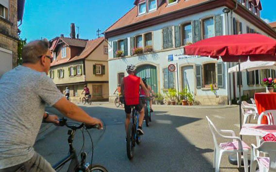 Cyclists ride up a hill as they leave Bad Duerkheim, Germany, on Weinstrasse Experience Day on Aug. 25, 2019. The event, which was expected to attract some 400,000 visitors this year, has been canceled because of the coronavirus pandemic.