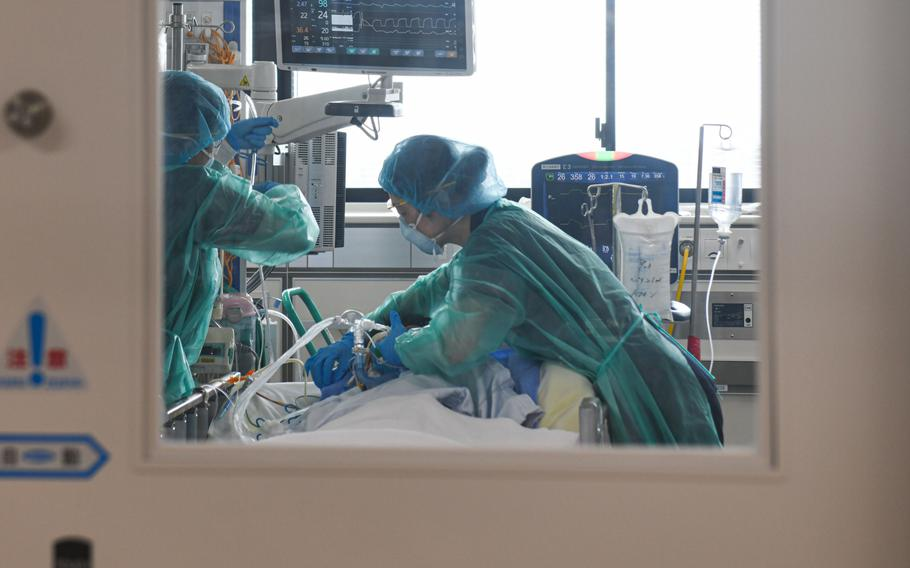 Healthcare workers treat a Covid-19 patient inside the ICU at Chiba University Hospital on Aug. 25, 2021.