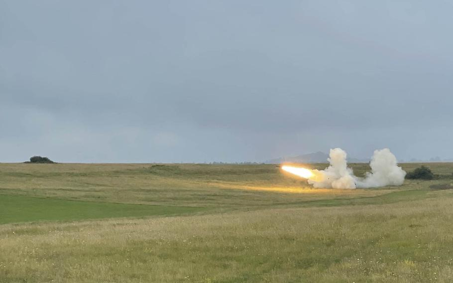 An M270 Multiple Launch Rocket System fires a rocket during an exercise the 41st Field Artillery Brigade conducted in conjunction with a family day at Grafenwoehr Training Area on Aug. 5, 2021.