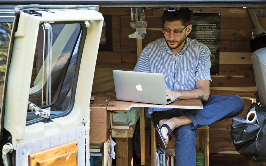 In this 2018, photo, U.S. journalist Danny Fenster works out of his van that he made into a home/office in Detroit. Myanmar's military-installed government spokesman said Thursday, Sept. 30, 2021, that Fenster, detained in the Southeast Asian country four months ago, was arrested for actions incompatible with his professional duties.