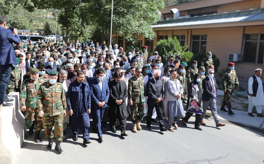Mourners march in procession at the funeral in Kabul on June 19, 2021, of Maj. Sohrab Azimi and two other elite Afghan soldiers who died fighting the Taliban days earlier.