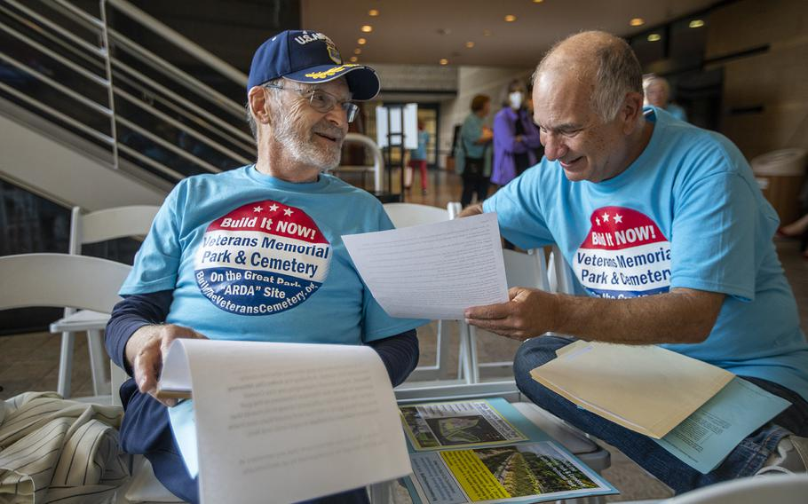 Gene Kaplin, left, and Don Geller go over notes outside an Irvine City Council meeting, where a discussion about a veterans cemetery in Irvine was on the agenda.