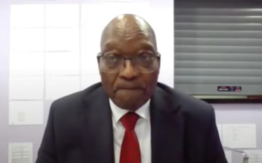 In this frame grab, former South Africa President Jacob Zuma appears on a screen virtually from the correctional service facility Estcourt, in Pietermaritzburg, South Africa, Monday July 19, 2021, where his corruption trial resumes.