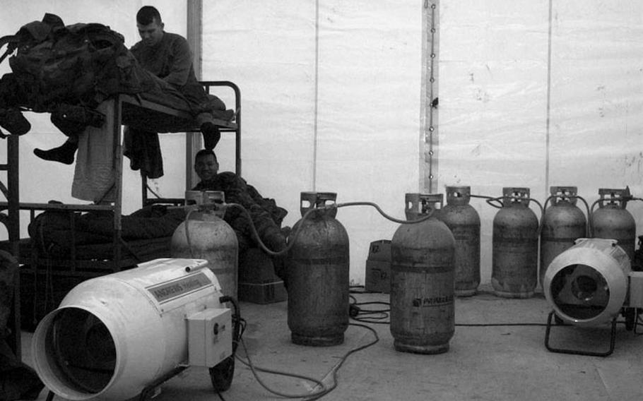 Taszar AB, Hungary, January, 1996: Gas heaters used to keep soldiers warm inside their tents put off noxious fumes, and must be monitored closely.