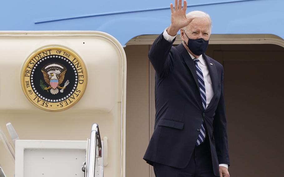 President Joe Biden waves from the top of the steps of Air Force One at Andrews Air Force Base, Md., on March 16, 2021.