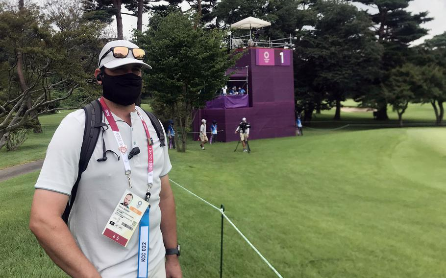 Patrick Bowman, the golf professional at the Air Force-run Tama Hills Golf Course, helps run the Olympic golf competition at Kasumigaseki Country Club in Saitama prefecture, Japan, Thursday, July 29, 2021.