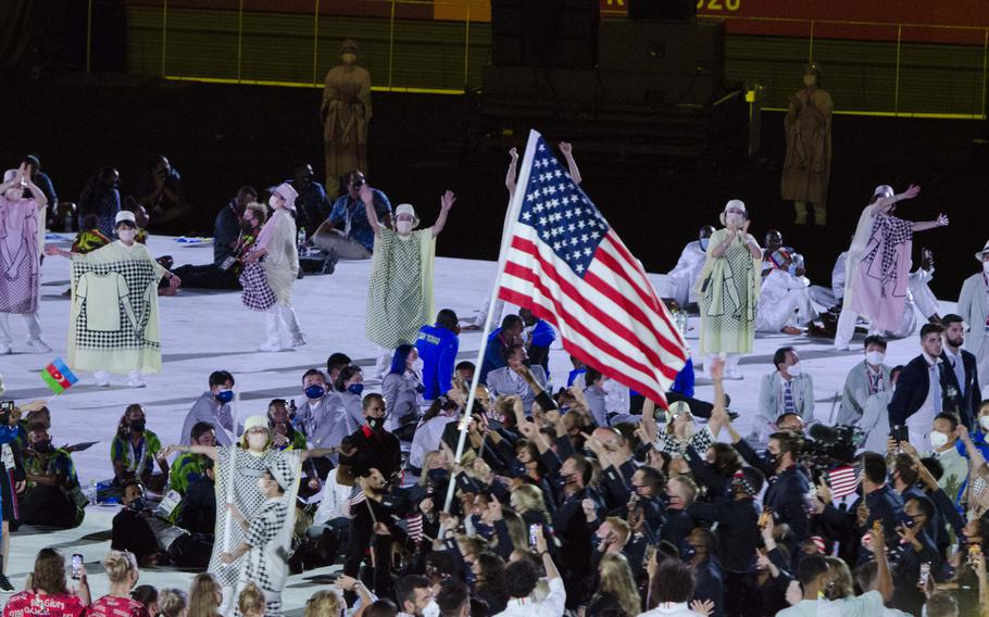 Member of Team USA march into Japan's National Stadium during Friday's Olympic opening ceremony.