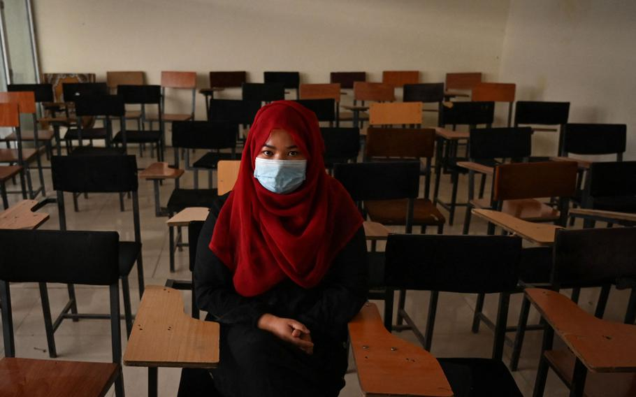 """A student sits inside a classroom after private universities reopened in Kabul, Afghanistan, on Sept. 6, 2021. The Taliban said this week that female students won't be able to return to Kabul University until """"a real Islamic environment"""" is provided for all."""