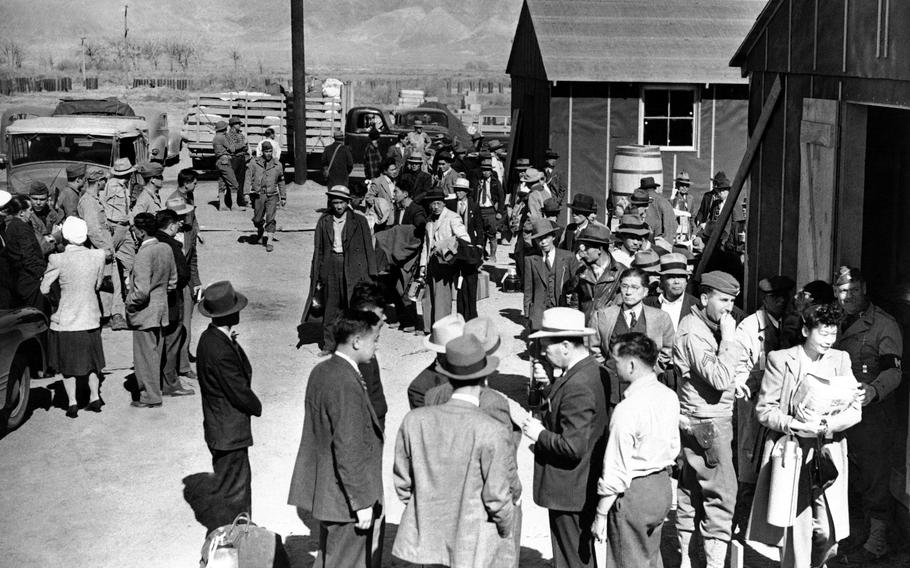 This March 23, 1942, photo shows the first arrivals at the Japanese evacuee community established in Owens Valley in Manzanar, Calif. Roughly 120,000 Japanese immigrants and Japanese-Americans were sent to camps that dotted the West because the government claimed they might plot against the U.S.