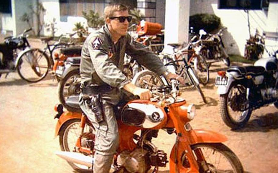 Air Force Col. Warren Anderson sits on a motorcycle in South Vietnam in this photo taken in 1965. He went missing about a year later when his RF-4C reconnaissance jet went off radar during a scouting mission over North Vietnam.