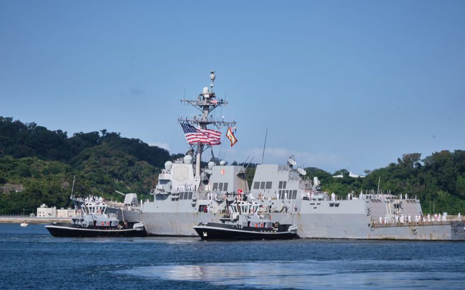 The guided-missile destroyer USS Ralph Johnson arrives at its new homeport, Yokosuka Naval Base, Japan, Monday, Oct. 4, 2021.