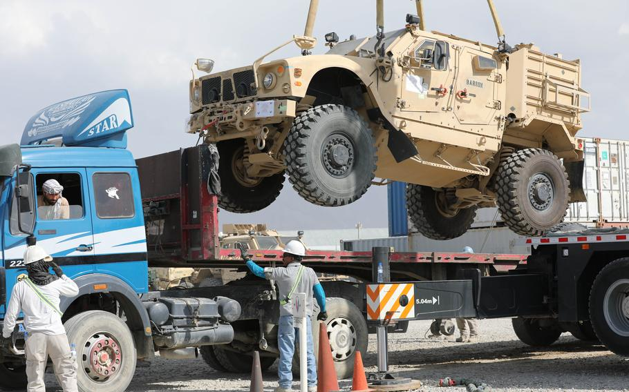 A Mine Resistant Ambush Protected vehicle is loaded on a flatbed trailer as part of the Army Field Support Battalion - Afghanistan, 10th Mountain Division cargo drawdown operation on Bagram Airfield, Afghanistan, July 12, 2020.