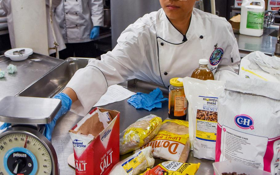 Petty Officer 3rd Class Anna Jenica Moralez prepares ingredients for Nancy Reagan's favorite chocolate chip cookies aboard the USS Ronald Reagan in the Arabian Sea, July 5, 2021. The treats were served July 6, on what would have been the former first lady's 100th birthday.