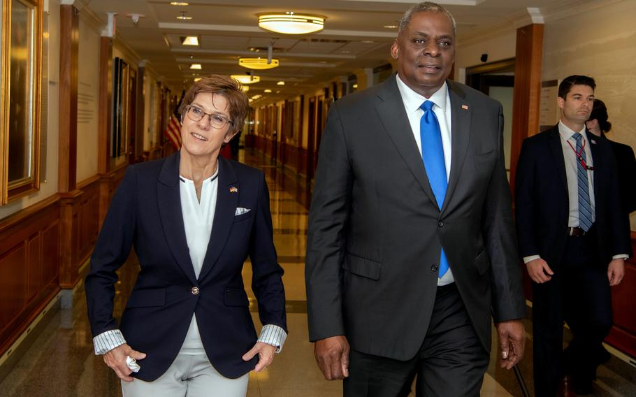 Defense Secretary Lloyd Austin and his German counterpart Annegret Kramp-Karrenbauer walk through the Pentagon on June 30, 2021. They notably discussed the tax sanctions imposed on hundreds of members of the Defense Department, which the United States says , violate a treaty.