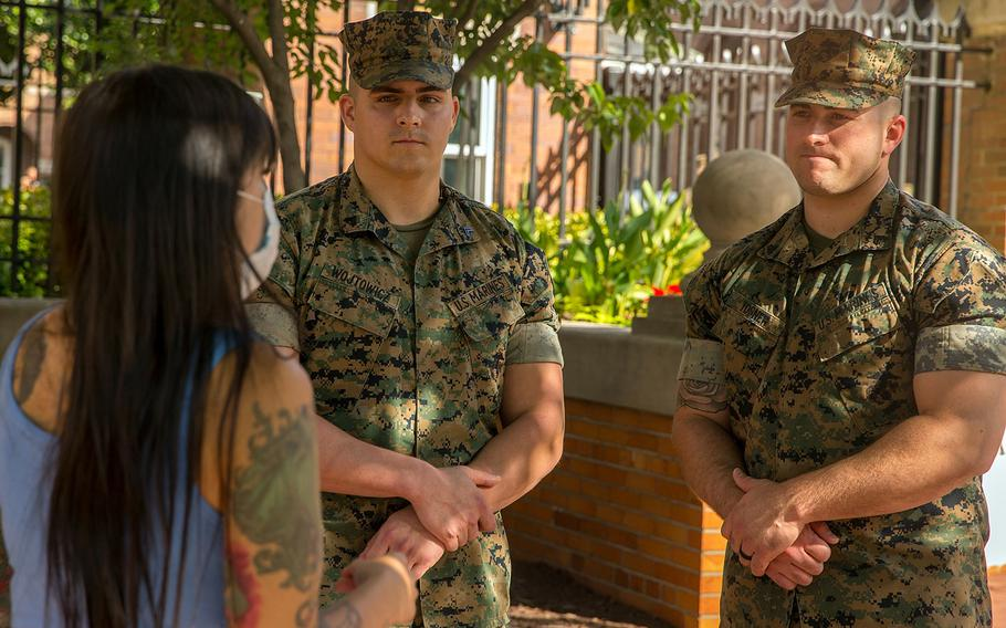 Virginia Waller-Torres talks to Cpl. Mitchell Wojtowicz, left, and Cpl. Jared Tosner after she met them at Marine Barracks Washington, Sept. 20, 2021. Waller-Torres thanked them for helping push her car out of floodwaters near Arlington Cemetery during a downpour on Sept. 16.