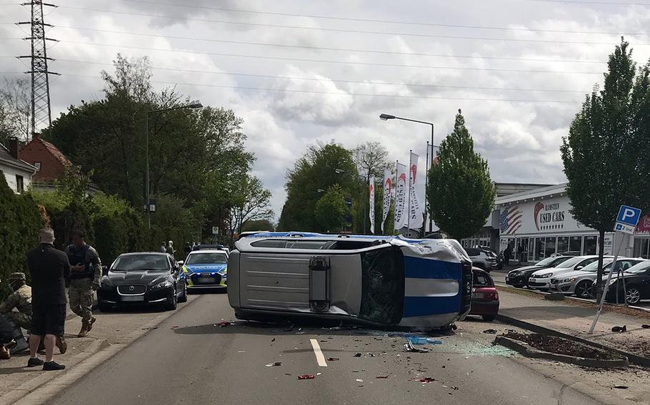 A U.S. military policeman lost control of his vehicle May 21, 2021, hit a parked car and then overturned, blocking Kaiserstrasse in Kaiserslautern, Germany, near Pulaski Barracks, local police said.  Police department Westpfalz