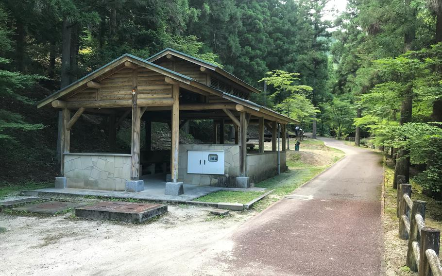 A pavilion for cooking and gathering stands near the platform camping sites at Jakuchikyo Camping Ground, Yamaguchi prefecture, Japan.