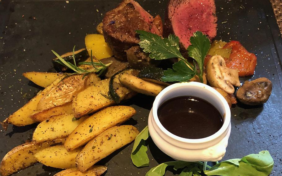 Another popular dish at the Swiss House in Bad Duerkheim, Germany, is the fillet steak accompanied with mushrooms, and potato wedges.