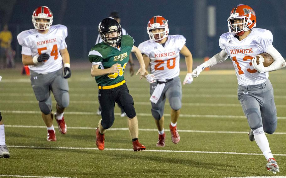 Nile C. Kinnick ballcarrier Justin Rose carries for some of his 30 rushing yards.