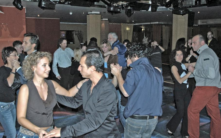 Italians and Americans dance the night away at a nightclub near Aviano Air Base, Italy, prior to the coronavirus pandemic. Italy is reopening discos and nightclubs Oct. 11, 2021, after being closed more than a year because of  pandemic restrictions.