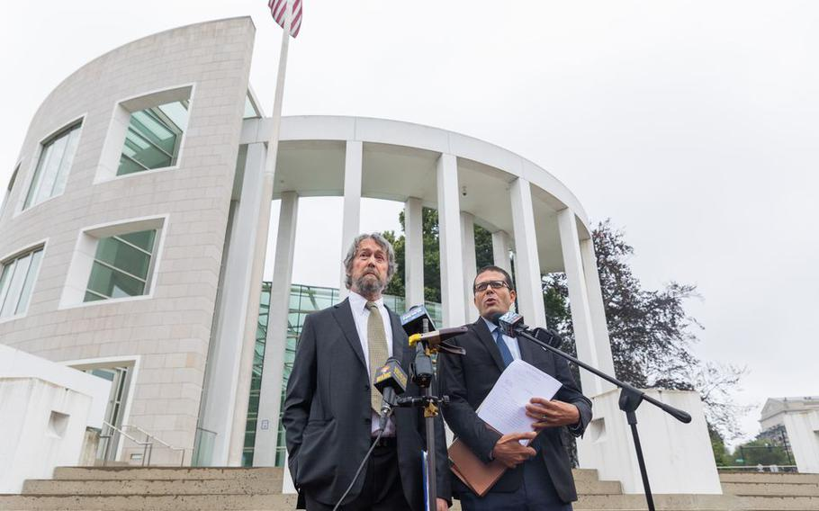 Attorneys Thomas Lesser, left, and Michael Aleo announce the filing of a class action lawsuit in U.S. District Court over deaths tied to a COVID-19 outbreak at the Holyoke Soldiers' Home, July 17, 2020.