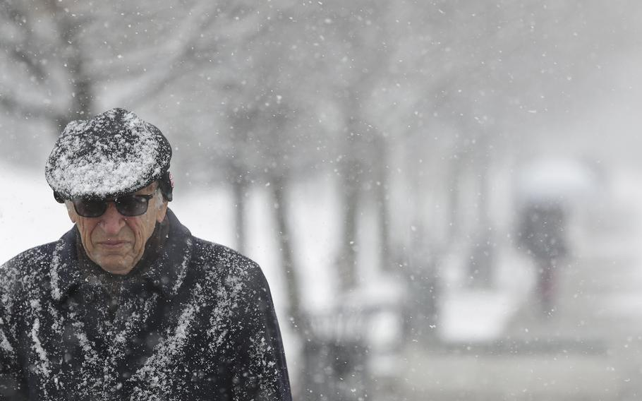 A man makes his way through snowfall in Sarajevo, Bosnia, Tuesday Jan. 22, 2019. Heavy snow descended on the Balkan countries causing havoc throughout the region.