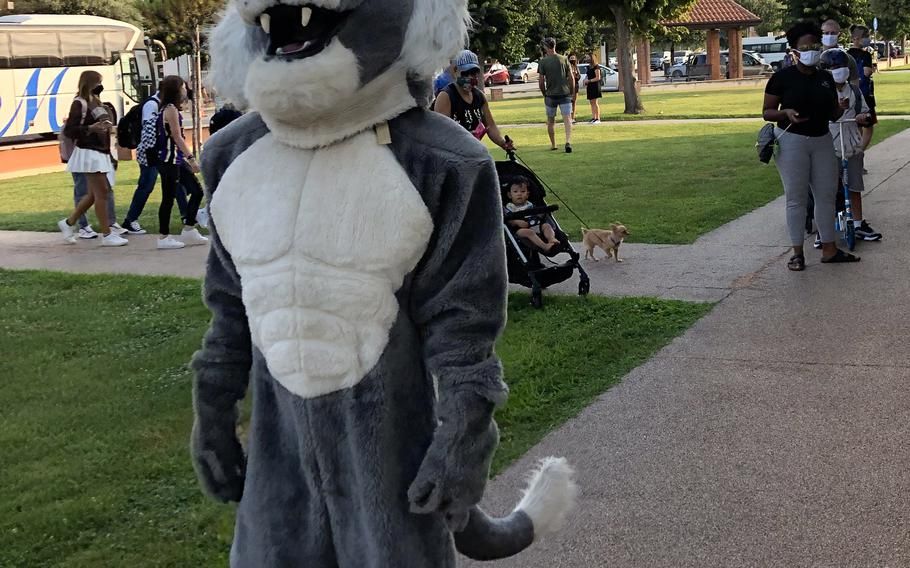 The Naples Middle High School mascot and teachers greet children and parents near the entrance Monday, Aug. 23, 2021.