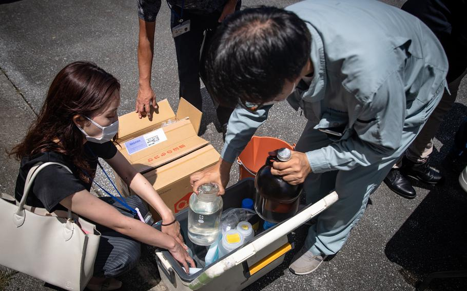 Japanese officials collected samples of treated wastewater at Marine Corps Air Station Futenma, Okinawa, Monday, July 19, 2021.