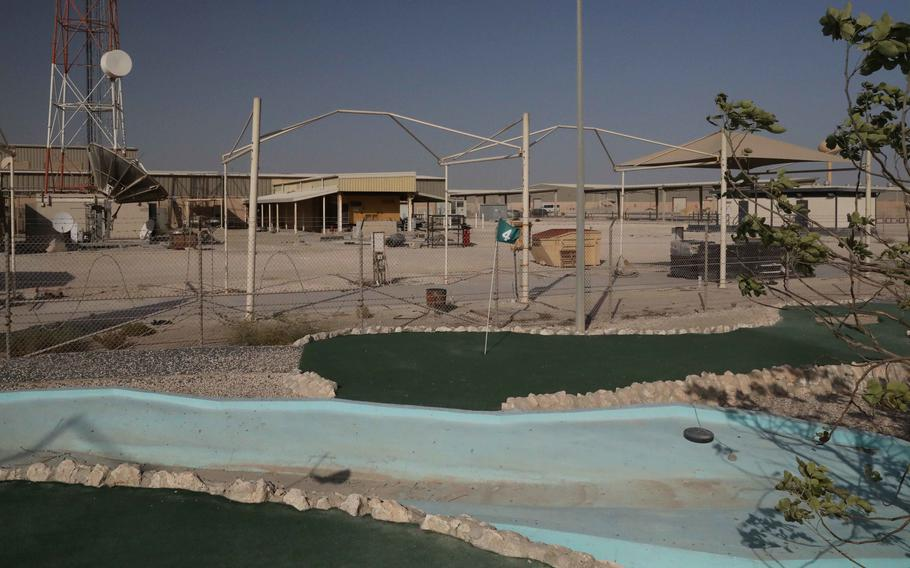 The flag on the fourth hole at the now-closed Camp As Sayliyah-Main, Qatar, miniature golf course waves in the wind on June 14, 2021. The U.S. Army shuttered CAS-Main and its two other installations in Qatar, Camp As Sayliyah-South and Falcon 78.