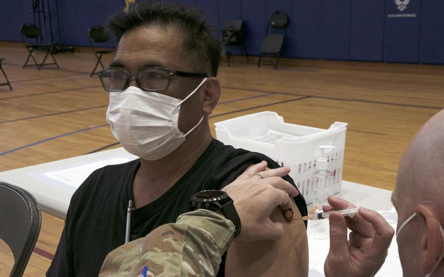 Firefighter Tadashi Seikima, 53, receives his first dose of the Moderna COVID-19 vaccine at Kadena Air Base, Okinawa, Wednesday, June 16, 2021.