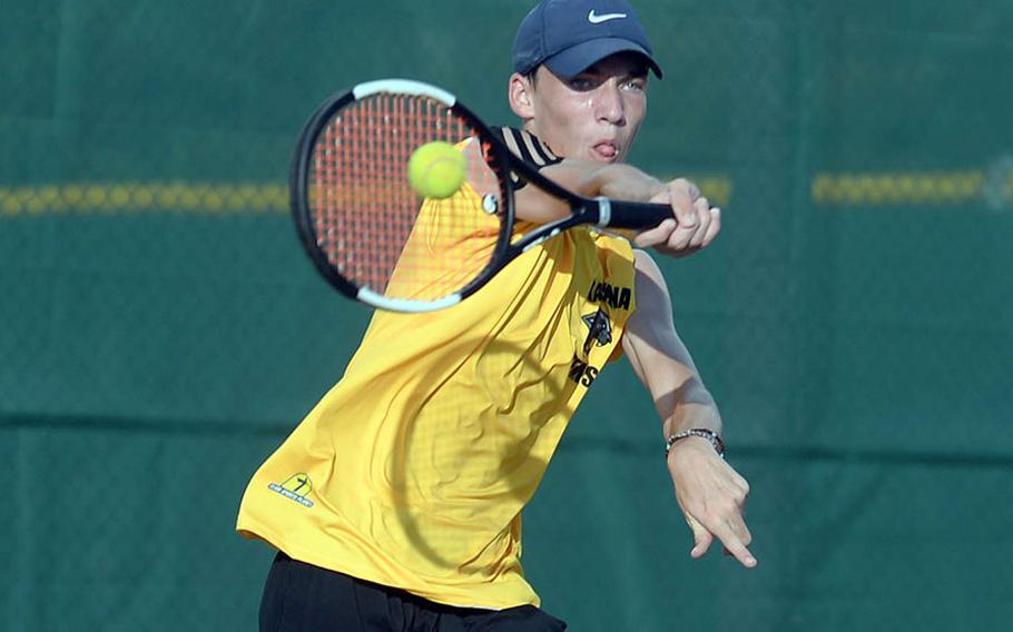 Kadena's Evan Davis smashes a forehand return against Kubasaki's Owen Ruksc during Wednesday's Okinawa tennis matches. Davis won 9-8 (7-4).