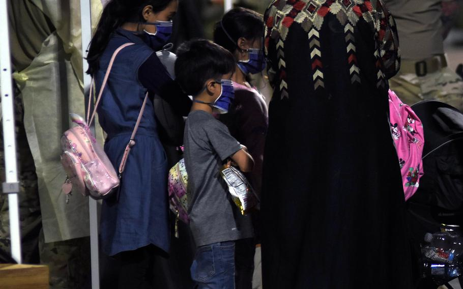 Many of the hundreds of evacuees from Afghanistan who arrived at Ramstein Air Base, Germany, on Friday, Aug. 20, 2021, were families with children.