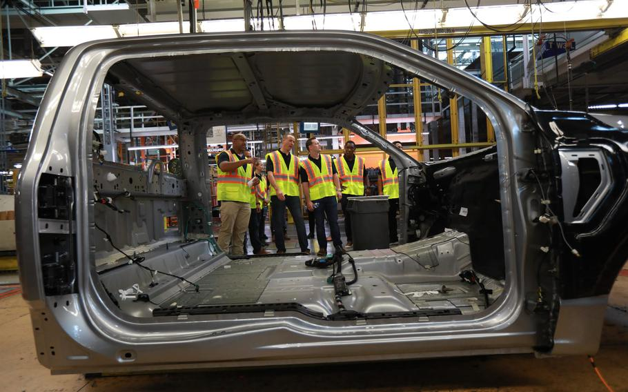 Blue Angels pilots tour the Ford Motor Co. Dearborn Truck plant assembly line on Aug. 3, 2021.