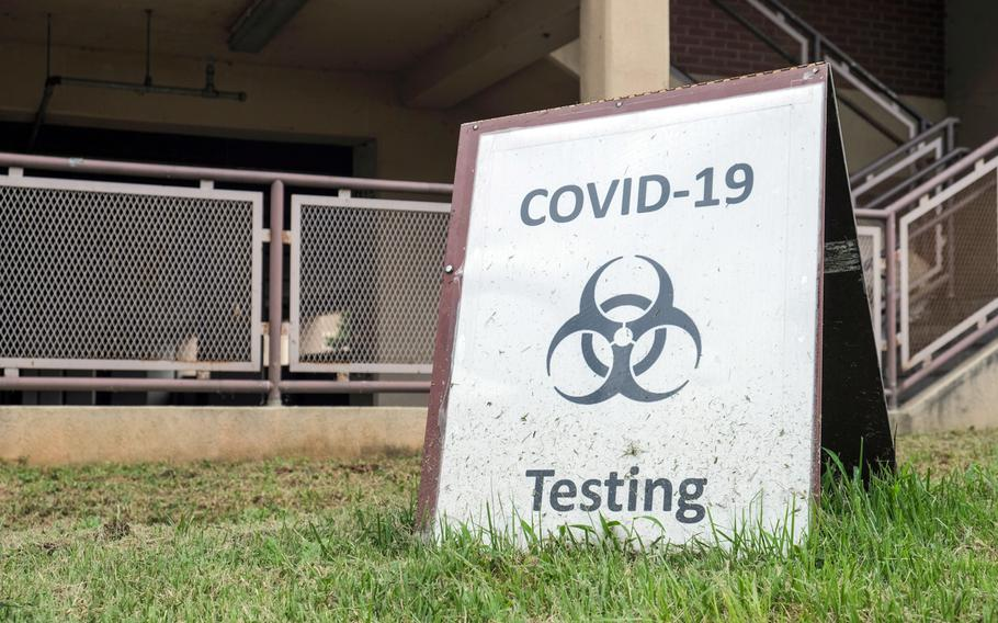 A sign points people to a COVID-19 testing site at Osan Air Base, South Korea, Sept. 1, 2020.