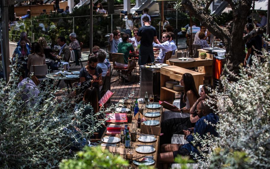 Customers on a restaurant terrace on Barceloneta promenade in Barcelona, Spain, on June 5, 2021.