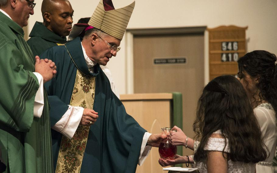 Timothy P. Broglio, archbishop for the military services, receives wine for communion at MacDill Chapel in Tampa, Fla., in 2019. Catholics in the U.S. military have the right to refuse the coronavirus vaccination if they have a conscientious objection to the inoculation, Broglio said in a statement Oct. 12, 2021.