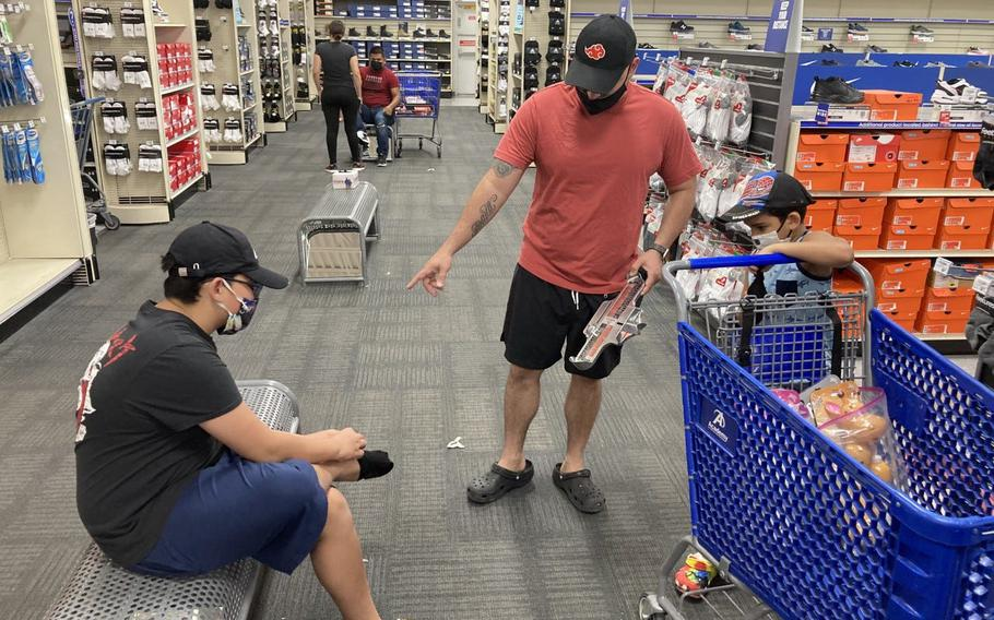 Staff Sgt. Eddie Hernandez used his $1,000 gift card to buy his boys tennis shoes at Academy Sports + Outdoors store Tuesday.