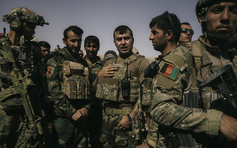 Gen. Sami Sadat talks with troops during a May 25 visit at Nazar outpost near Lashkar Gah.