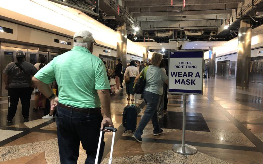 Air travelers head to departure gates at Denver International Airport in Colorado on June 6, 2021. Germany tightened coronavirus restrictions in mid-August for travelers from the United States, where the delta variant has pushed new infections back up to nearly 129,000 a day.