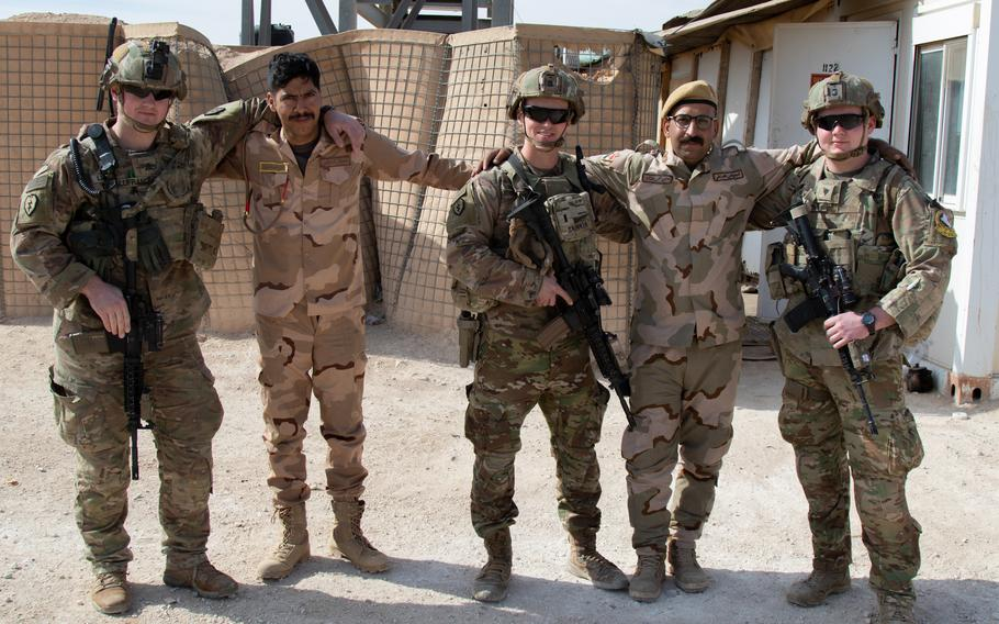 U.S. Soldiers with 1st Battalion, 5th Infantry Regiment, 1st Stryker Brigade Combat Team, 25th Infantry Division, take a photo with Iraqi troops guarding the perimeter of Al Asad Airbase in western Iraq, Feb. 15, 2020. U.S. troops regularly share food and other supplies, as well as tactics and procedures with Iraqi troops to reinforce the security partnership between the two nations. (U.S. Army photo by Sgt. Sean Harding)