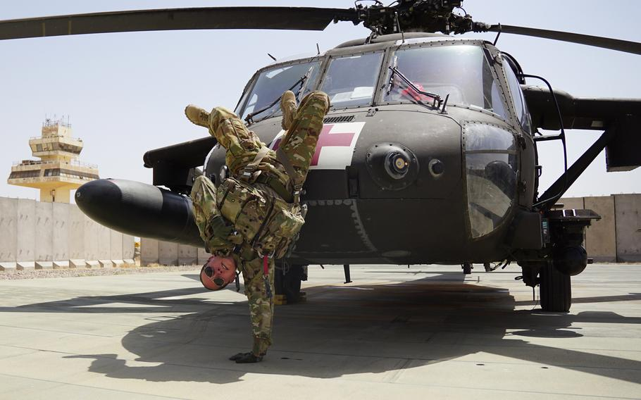 Staff Sgt. Brianna Pritchard, an Army National Guard UH-60 Black Hawk helicopter mechanic from Anchorage, Alaska, demonstrates her breaking moves at al Asad Air Base, Iraq.