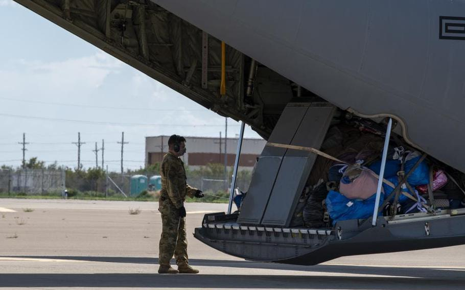 An Airman assigned to Task Force-Holloman prepares to unload luggage in support of Operation Allies Welcome, Aug. 31, 2021, on Holloman Air Force Base, N.M. The Department of Defense, through U.S. Northern Command, and in support of the Department of Homeland Security, is providing transportation, temporary housing, medical screening, and general support for up to 50,000 Afghan evacuees at suitable facilities, in permanent or temporary structures, as quickly as possible.