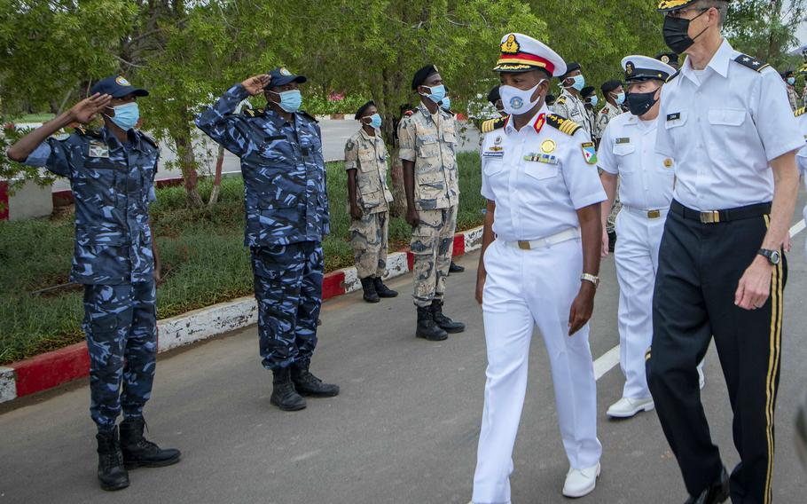 Col. Ahmed Daher Djama, of the Djiboutian navy, walks with Maj. Gen. William Zana, right, Combined Joint Task Force-Horn of Africa commander, July 25, 2021, following the opening ceremony of exercise Cutlass Express 2021 in Djibouti.
