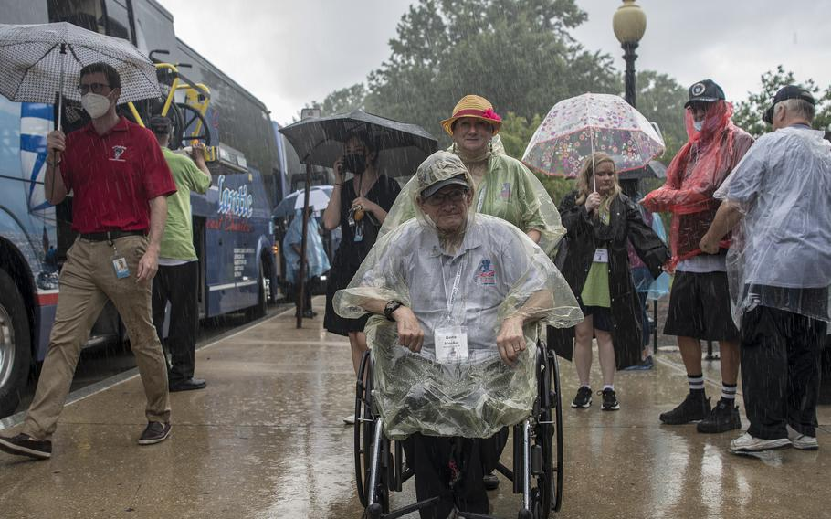 Marine Corps veteran Gene Meske arrives at the World War II Memorial in Washington, D.C., on Wednesday, Aug. 18, 2021, as the rain pours down prior to an Honor Flight ceremony that paid tribute to veterans from World War II, the Korean War and the Vietnam War.