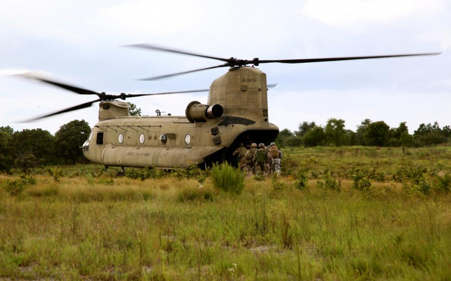 Soldiers load a CH-47 Chinook following training at Fort Bragg, N.C., on Sept. 8, 2015. Helicopter training for 100 Fort Bragg-based special operations soldiersupset some Bloomington, Indiana, residents unaware of U.S. Army plans for training in town.