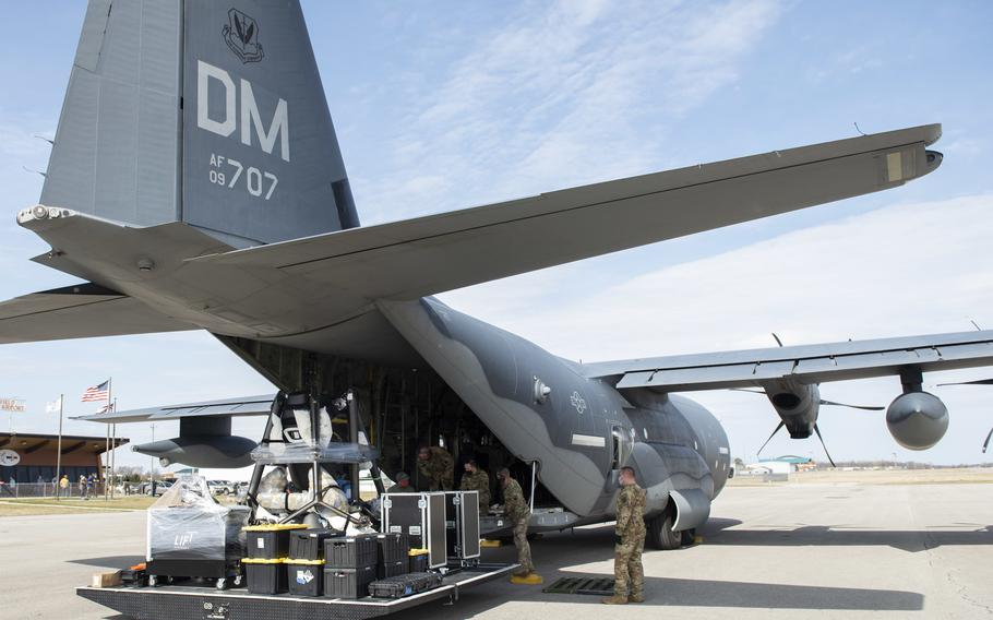 U.S. Airmen from the 79th Rescue Squadron and the 571st Mobility Support Advisory Squadron work to load the LIFT aircraft eVTOL onto a C-130J Super Hercules from Davis-Monthan Air Force Base, Arizona, at the Springfield-Beckley Municipal Airport, Ohio, March 23, 2021.  This marked the first time the LIFT electrical vertical takeoff and landing aircraft, or eVTOL, was transported using military aircraft.