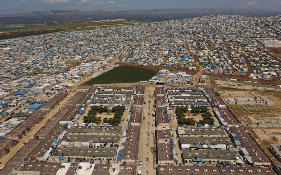 A refugee camp on the Syrian side of the border with Turkey in Idlib province, Syria, is seen on April 19, 2020. Millions of Syrians risk losing access to lifesaving aid, including food and COVID-19 vaccines if Russia gets its way at the Security Council by blocking the use of the last remaining cross-border aid corridor into northwestern Syria, an international rights group said Thursday, June 10, 2021.