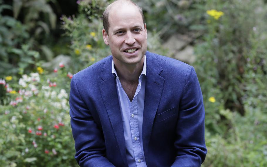 Britain's Prince William speaks with service users during a visit to the Garden House in Peterborough, England. Prince William has criticized some of the world's richest men for using their wealth to fund a new space race and space tourism, and called on the world's great minds to fix the planet first. The Duke of Cambridge spoke to the BBC about climate anxiety, COP26, space travel, and his family's long-standing commitment to environmental issues ahead of his inaugural Earthshot prize awards ceremony Sunday, Oct. 17, 2021.