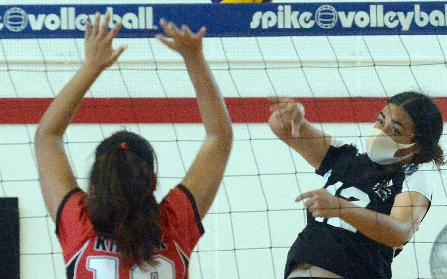 Zama's Kierstyn Aumua spikes against Nile C. Kinnick's Cierra San Nicolas during Saturday's DODEA-Japan volleyball match. The Red Devils won in four sets.
