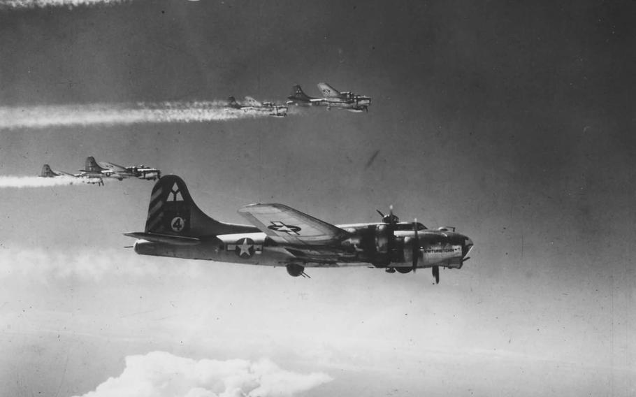 B-17 Flying Fortresses assigned to the 97th Bombardment Group fly into formation during World War II.